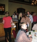 Guests mingling and trying out the large selection of wine!